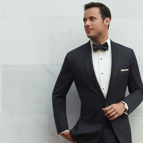a black tuxedo complemented with a white shirt and #pocketsquare is a  classic look IBWBAEO