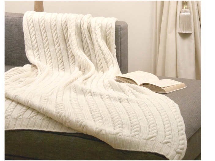An elaborate king size cable knit blanket