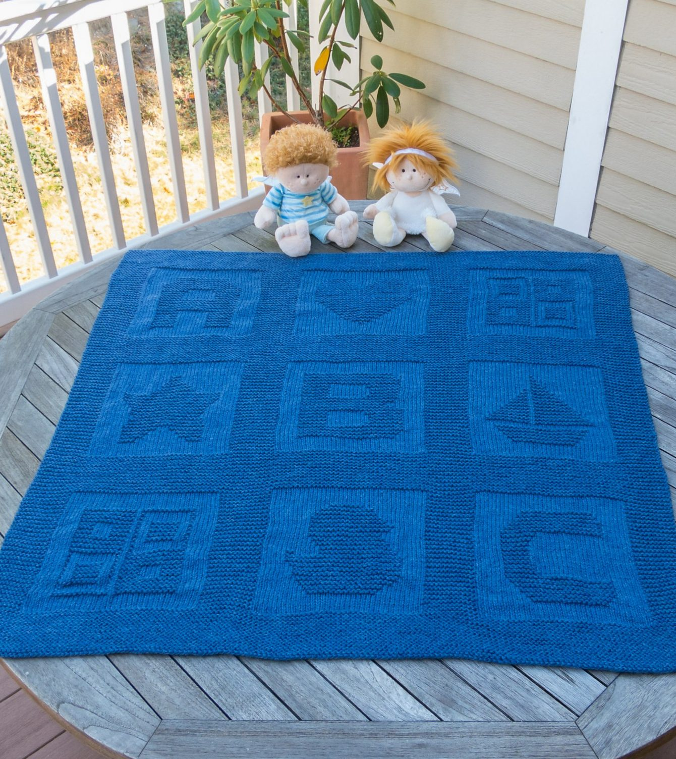 Knit baby blanket to keep your bundle of joy warm and comfortable