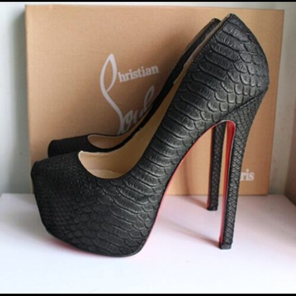 louis vuitton shoes - a pair or red bottom heels. YITLNEP