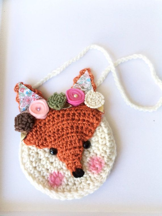 Meet Fiona the Fox! She is part of our crochet purse line and is a