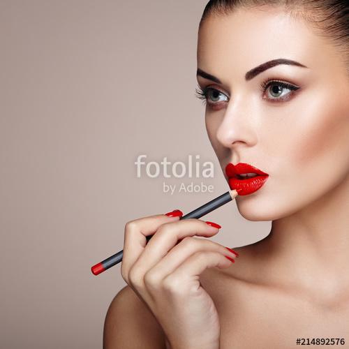 Beautiful Woman paints Lips with Lipstick. Beautiful Woman Face