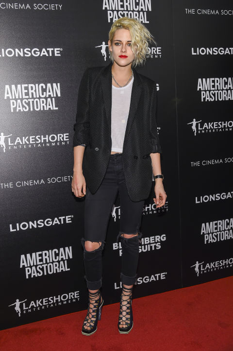 kristen stewart style kristen stewart opts for a tough look of distressed jeans and lace up heels GCKGTAD