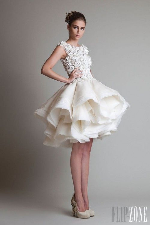 Why you need to consider a short wedding dress for your big day