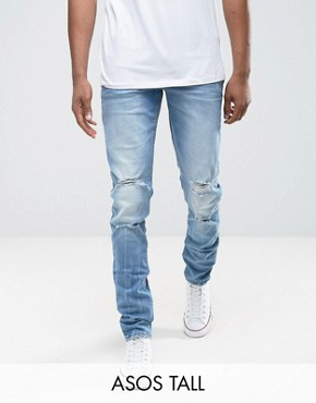 skinny jeans for men asos tall skinny jeans in mid wash blue with rips RDOHGLX