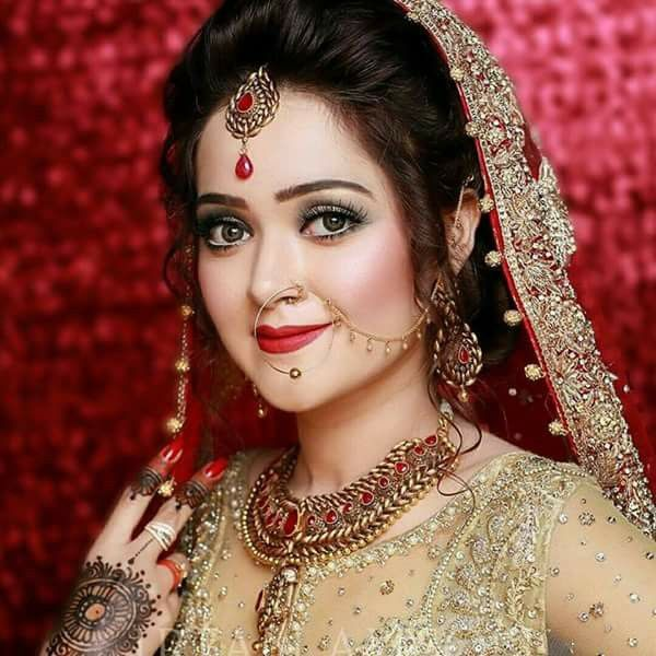 bridal makeup in red dress - Fabulax Style