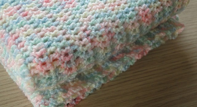 Wrap an easy crochet baby blanket, around   your baby for a deep nap