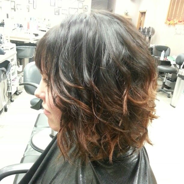 Dark brown color with a copper ombre effect. Short hair. Bob. Bangs